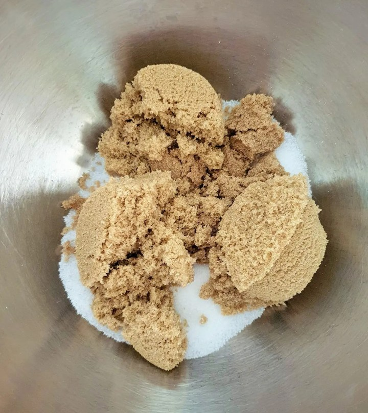 Brown sugar in a stainless steel bowl.