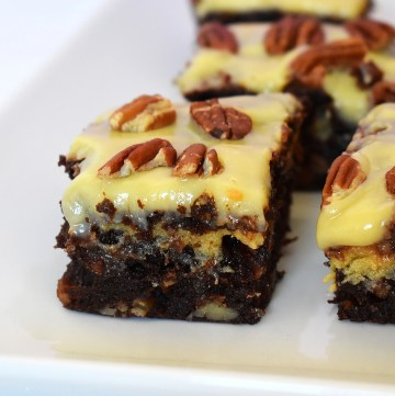 Caramel pecan brownie on a white plate.