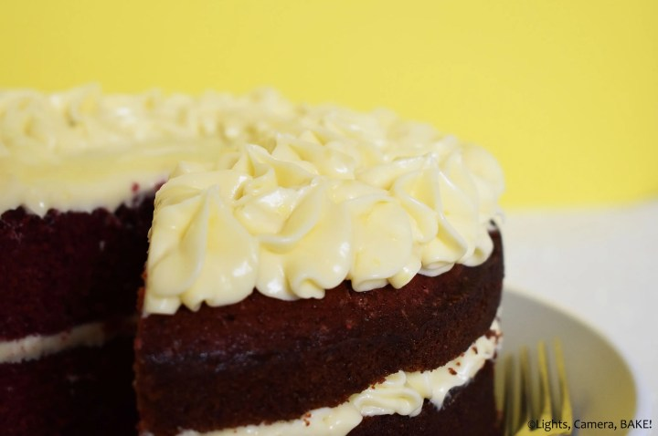 Cream cheese icing topped red velvet cake.