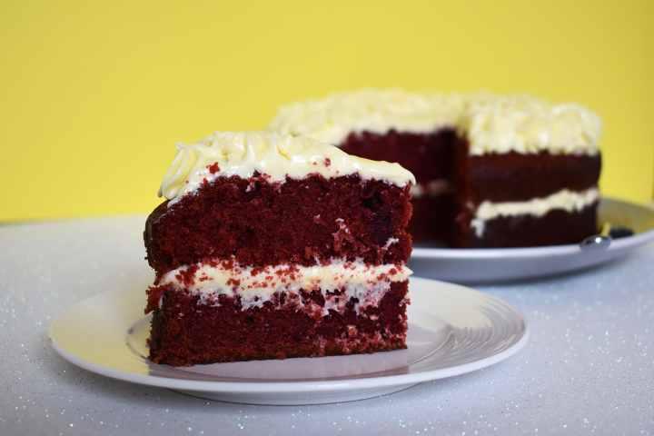 Slice of layered red velvet cake.
