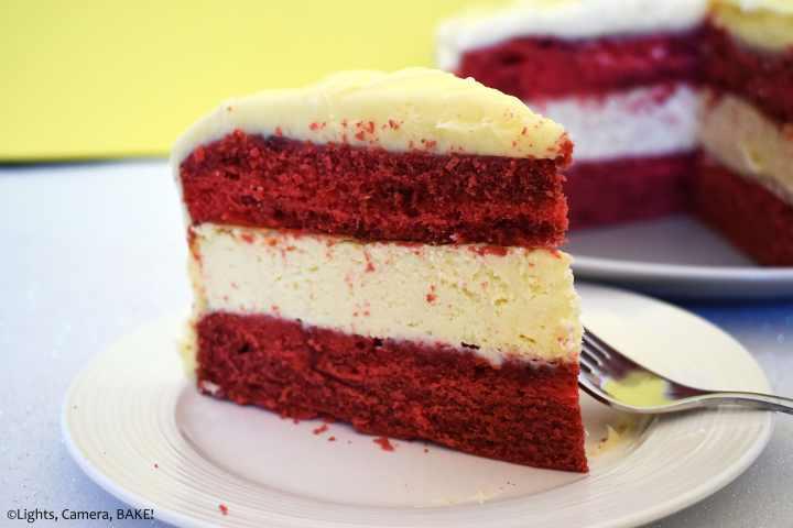 Slice of red velvet cheesecake cake on a plate.