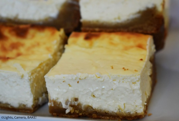 Slice of Caramilk brownie cheesecake on a plate.