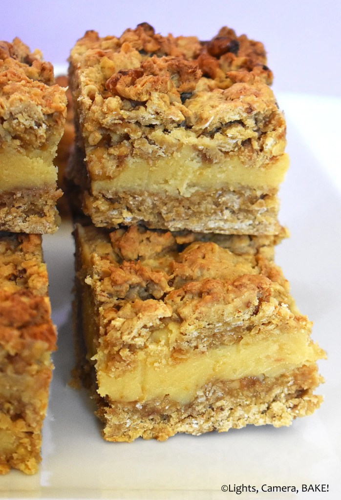 Pieces of walnut caramel slice on a plate.