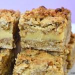 Candied walnut oat slice on a purple background.