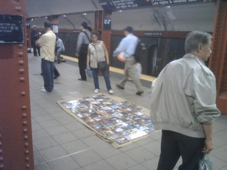 Selling counterfeit DVD's a the 53rd and Lexington  statioin