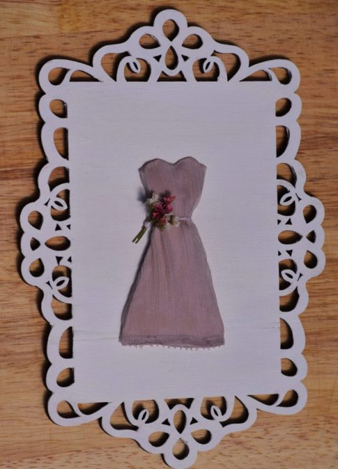 An easy and inexpensive craft, this is my little wedding dress keepsake that doubles as decor. It could easily be made as a little girl's or nursery decor.