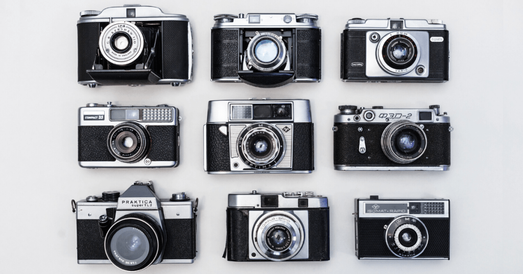 Several cameras on a gray background