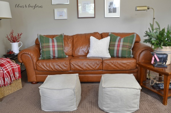 leather couch and plaid pillows Christmas decor