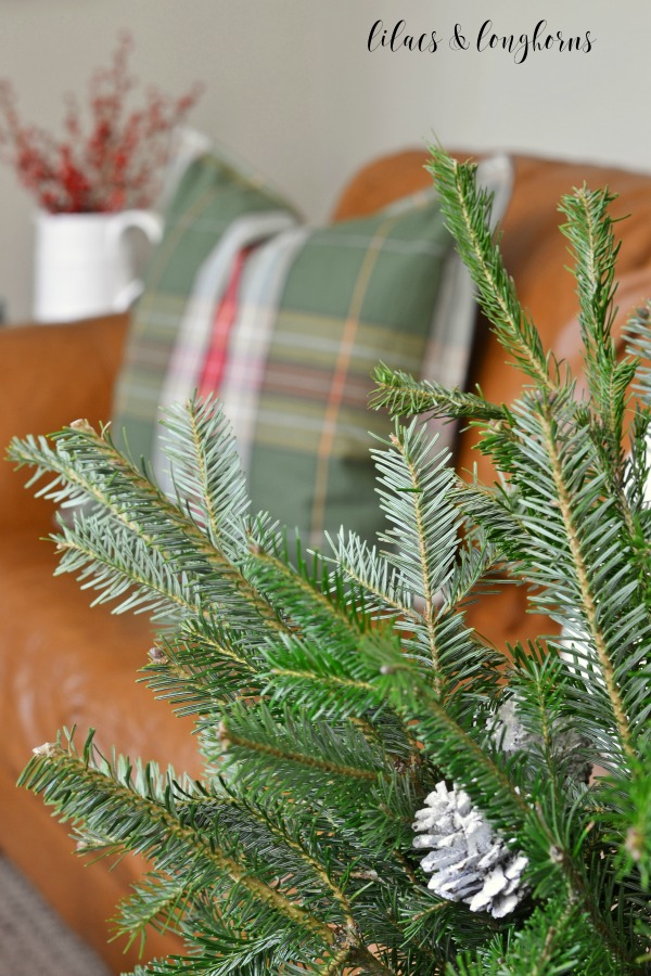 green plaid pillows and fresh evergreen