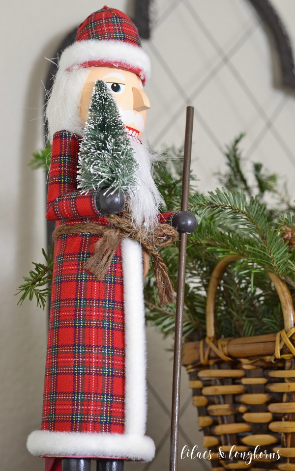 nutcracker with plaid coat and Christmas tree