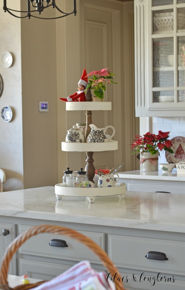3-tiered stand with elf on the shelf