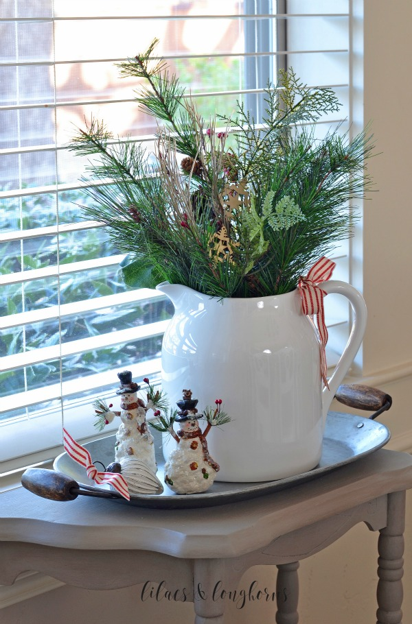 simple Christmas table scape white pitcher snowmen