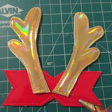 Glue antlers to base