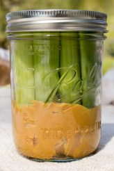Celery and Peanut Butter in a mason jar