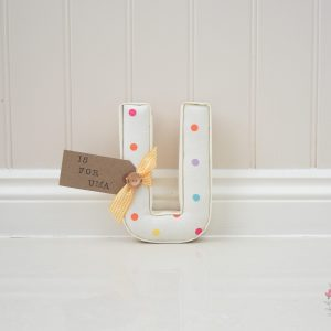 Personalised Wall Letter multicoloured dotty wall letter Personalised Wall Letter handmade in Dotty sunshine Clarke & Clarke. White fabric with pink, orange, purple and blue spots / dots on. Available now next day dispatch. Lilymae Designs