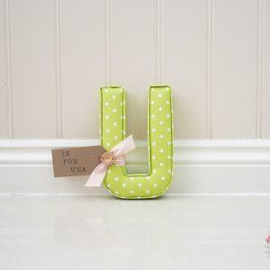 green polkadot wall letter