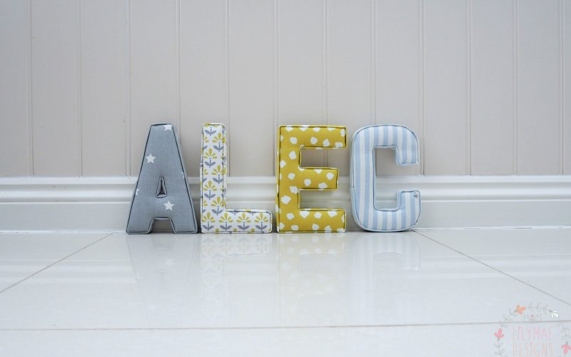 Blue & Yellow boys nursery inspiration Alec fabric letters grey with white stars, pale blue striped fabric. Lilymae Designs