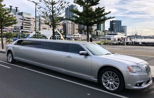 silver color Chrysler stretch limo hire in Melbourne Docklands waiting for customers
