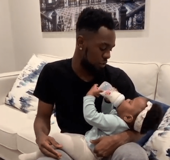 DaddyDuties! Patoranking shares video of himself bottle-feeding his adorable daughter, Wilmer.