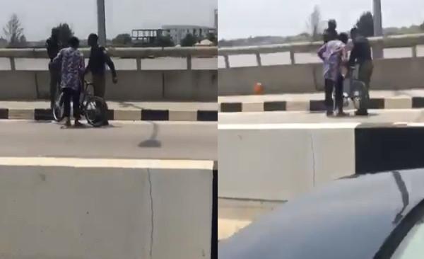 Lady confronts policemen harassing bicycle rider in Lagos lindaikejisblog
