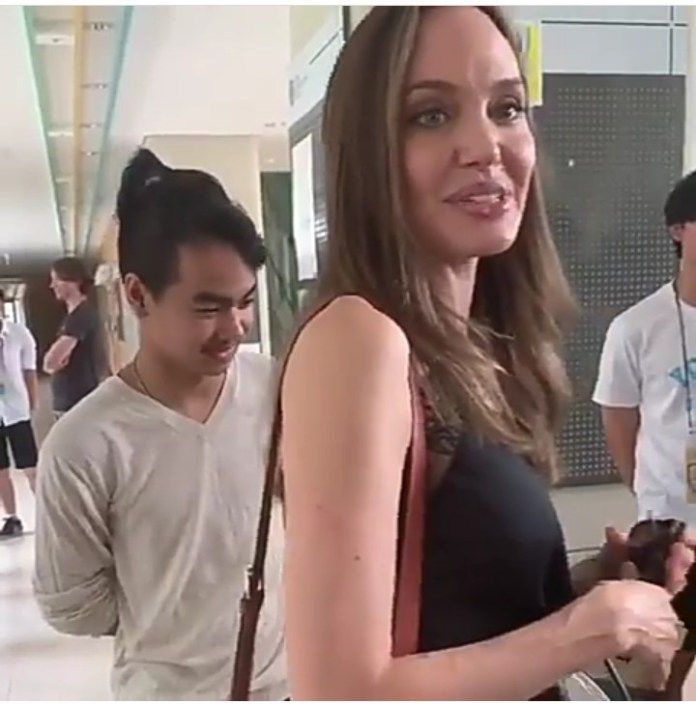 Emotional Angelina Jolie drops her son off at college in South Korea and chats with his classmates (video)