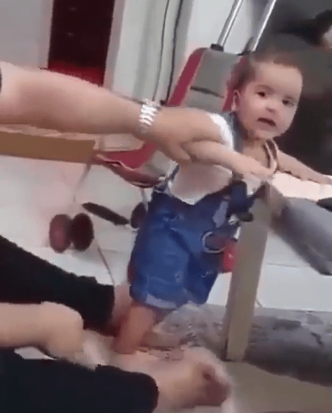 Heartbreaking video shows man slapping a baby and flinging him on the floor multiple times as he forces him to stand on his own