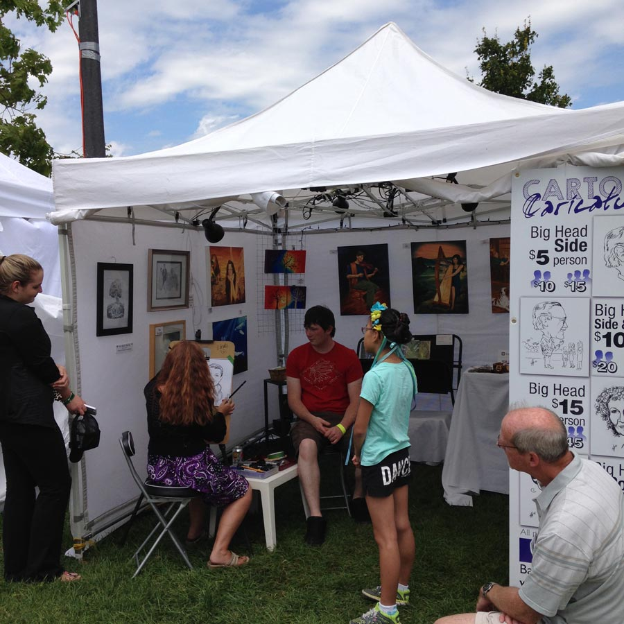 Caricature artist drawing at summer outdoor event