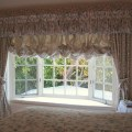 Window with overwhelming valence, curtains and austrian shade