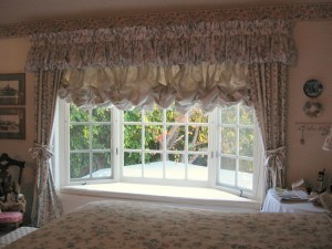 Window treatments with overwhelming valence, curtains and austrian shade