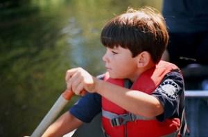 feng shui declutter summer, young boy canoeing