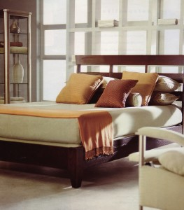 double bed with headboard against window wall