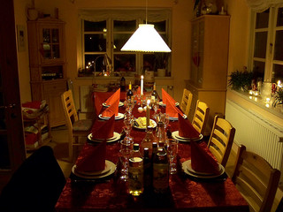 feng shui harmonious lighting with candles at a dinner table.