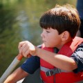 young boy canoeing, feng shui vacation