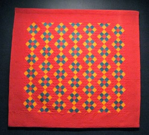 Pilgrim - Roy Collection quilt in red and marigold