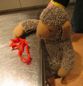 teddy bear playing with cookie cutters