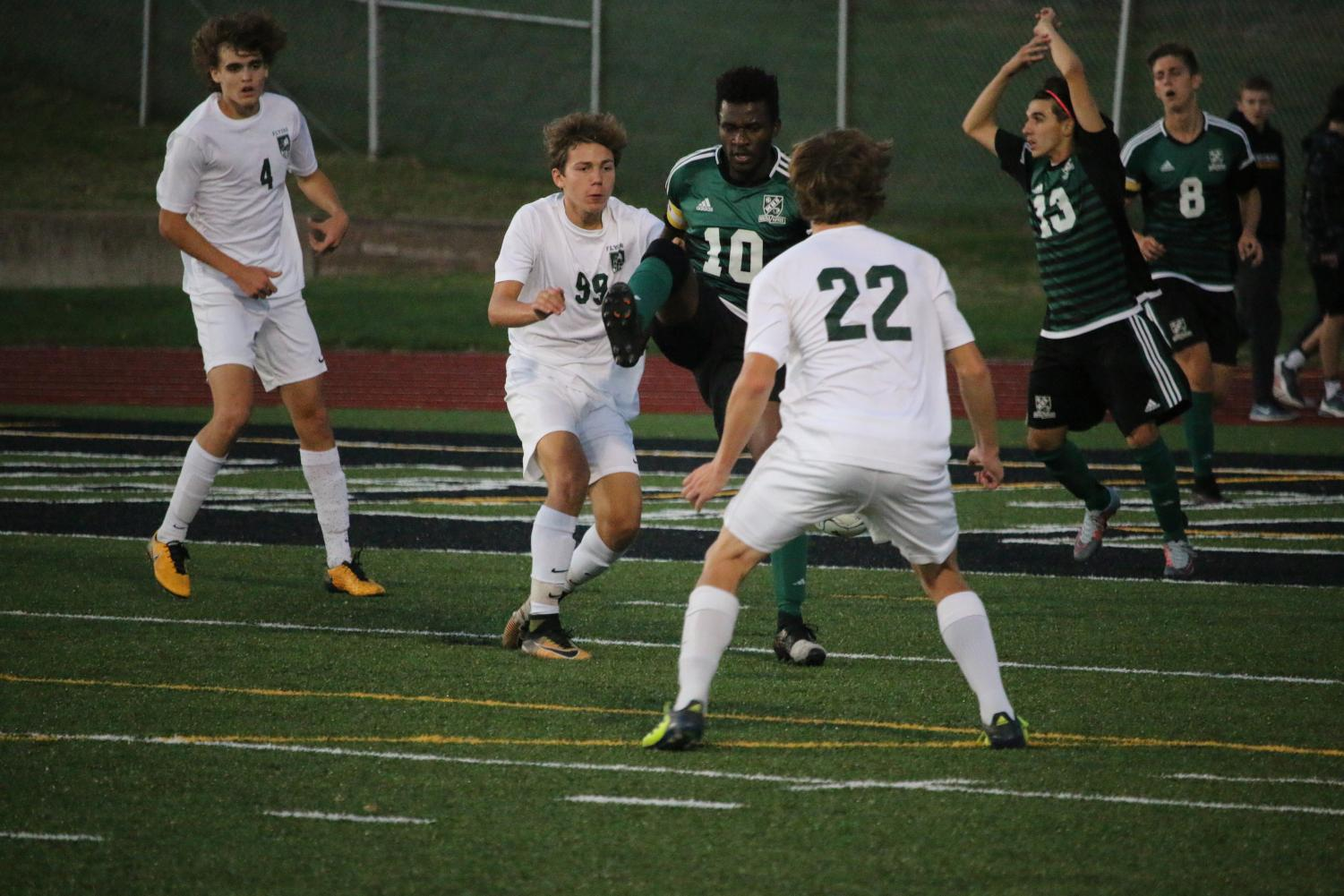 Thomas Kleinbach (12, #4), Nick Merlo (9, #99), and Dan Baudendistel (11, #22) fight with Mehlville for the ball.  The boys lost to Mehlville 1-0 in the District Finals.