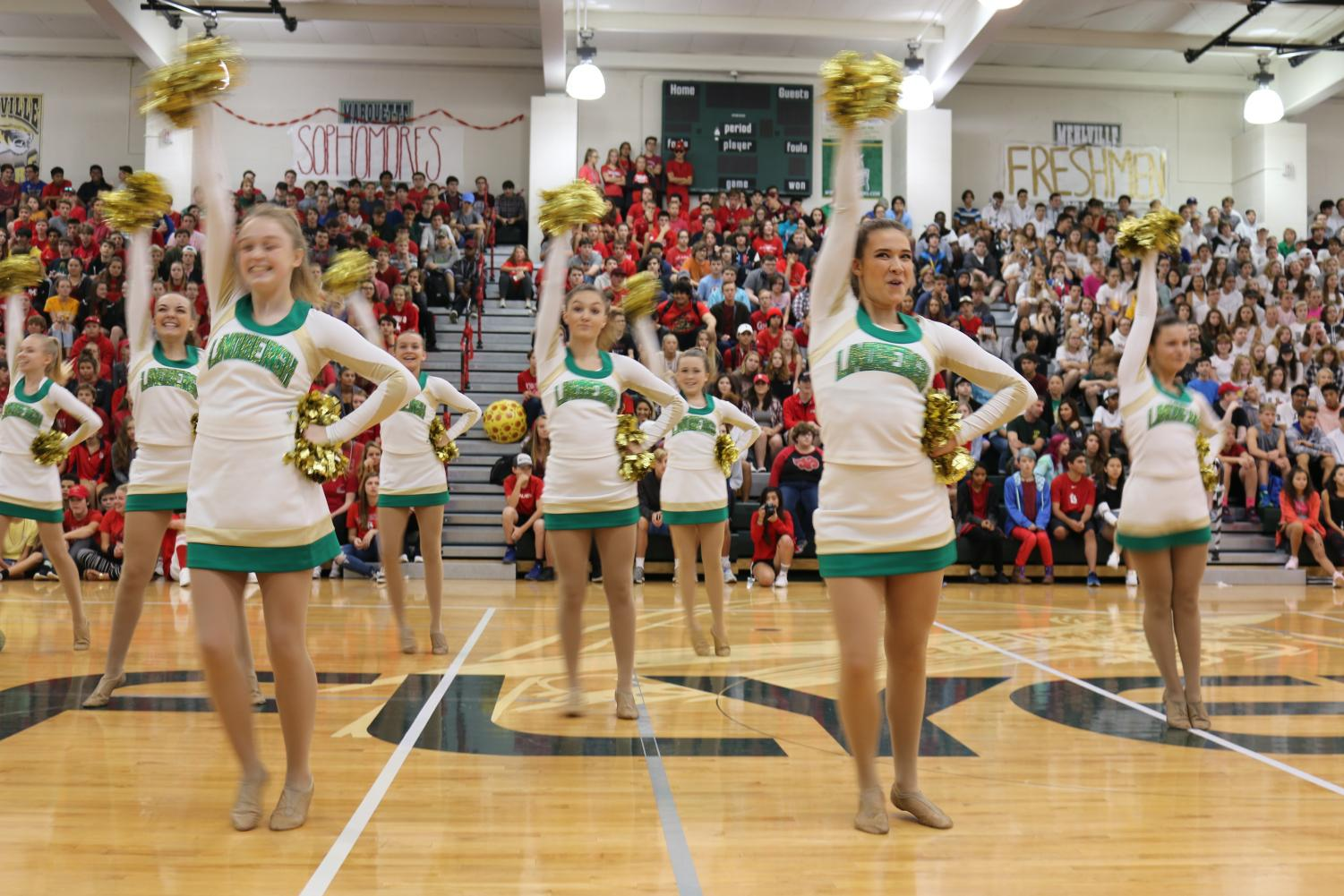Flyerettes perform for one of the first times of the year at the 2017 Pep Assembly led by captain Maria Wasenius (12).