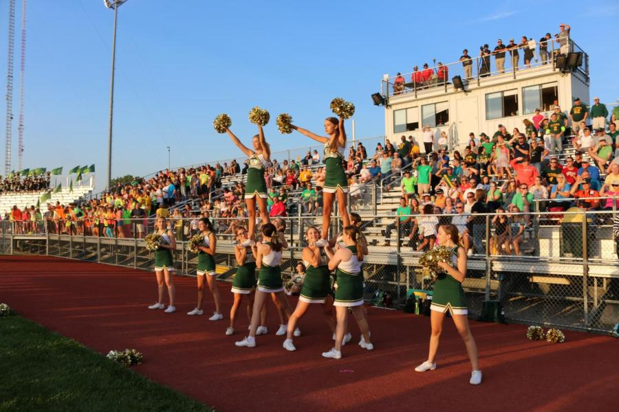LHS+Cheerleaders+led+by+captain+Aly+Rezek+%2812%29+get+into+formation+before+the+game.