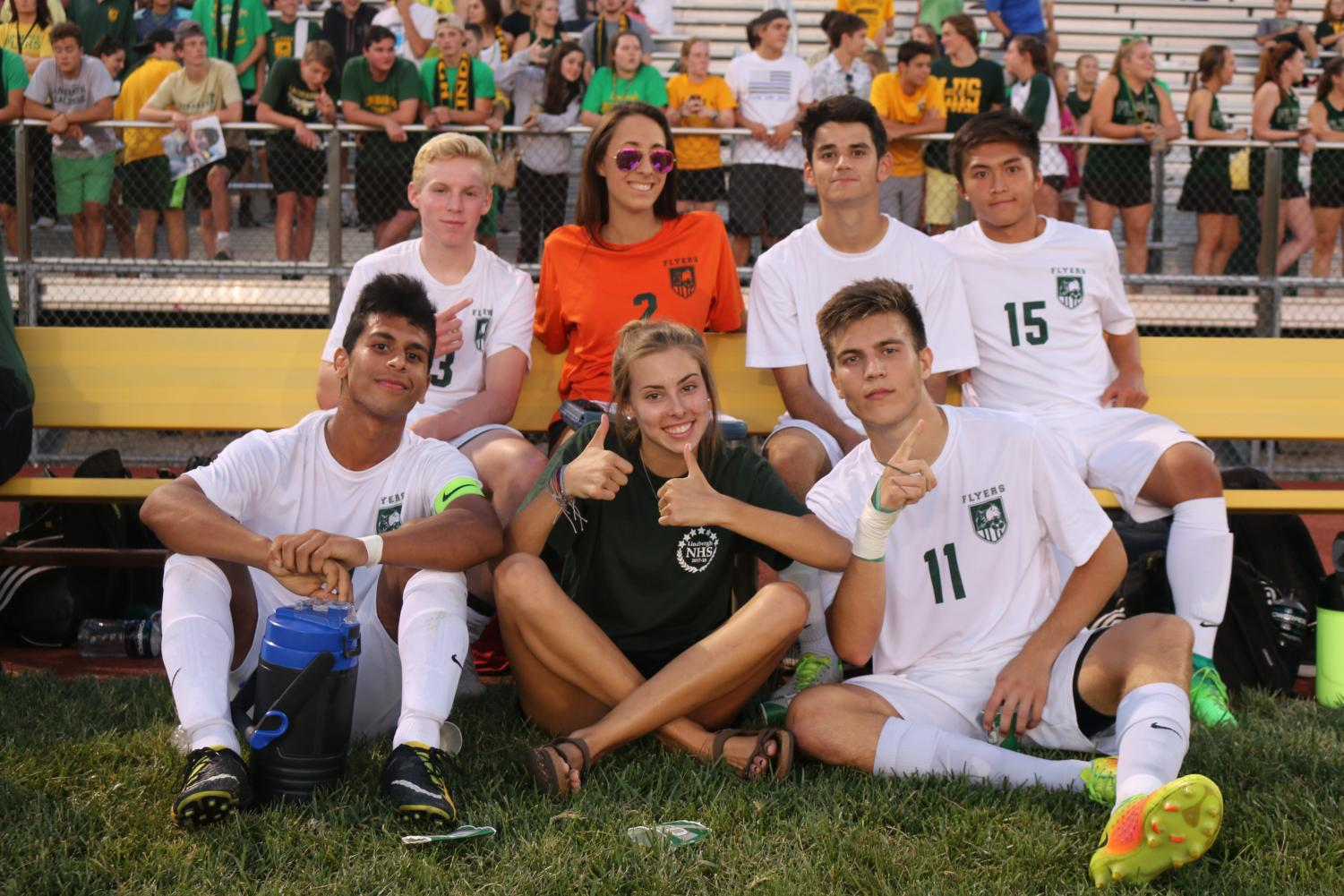 Senior soccer players Garret Butz (12), Arman Kovac (12), David Ha (12), Sadiq Hasan (12) and Muhamed H. (12) spend their bench time with managers Sydney Marino (12) and Caroline Yenzer (12).