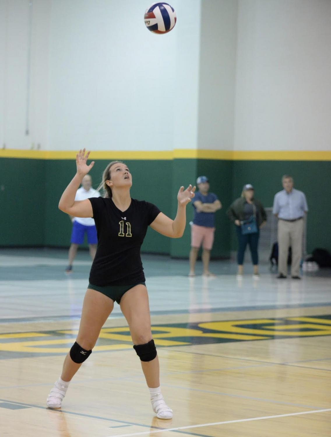 Junior Phalyn Mitchell serves in a match against Nerinx Hall.  The right side hitter has been a key component to the Flyer's success.