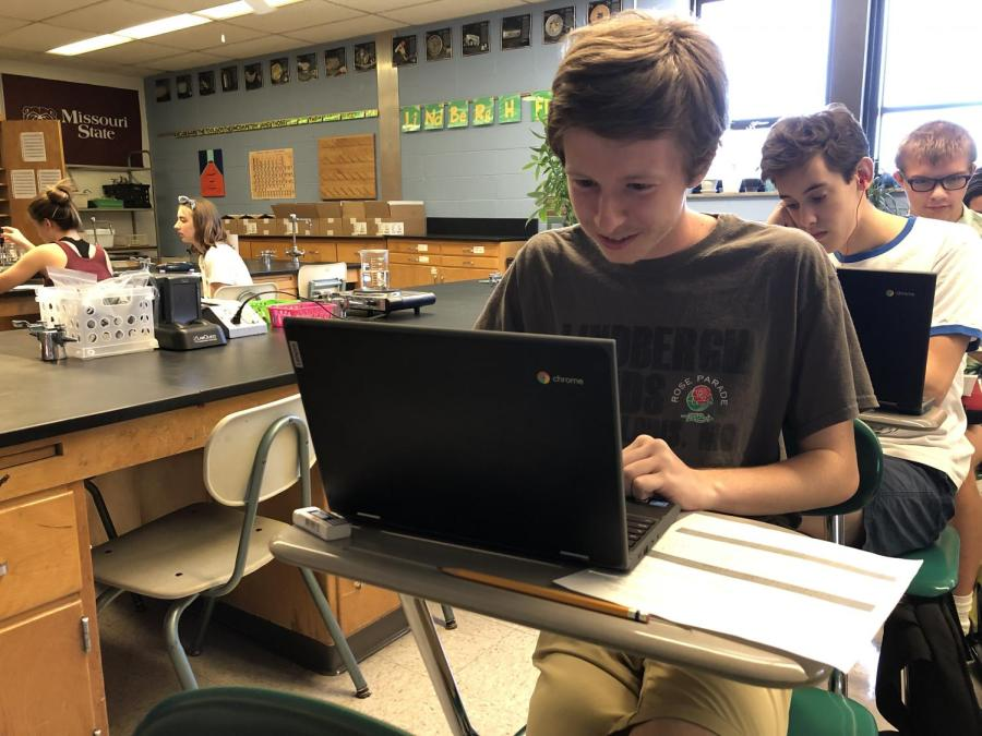 Martyn+Seeker+%2812%29+works+on+a+chemistry+lab+assignment+in+Mr.+Dougherty%E2%80%99s+class%2C+using+one+of+the+district-provided+Chromebooks.%0A