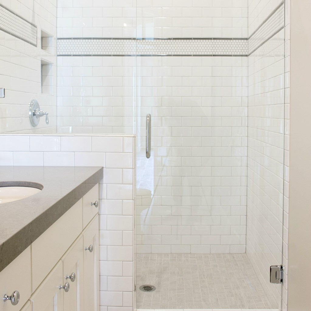 white tiled bath in classic mountain home