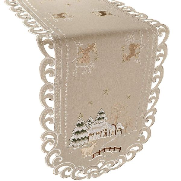 embroidered snow scene on beige table runner