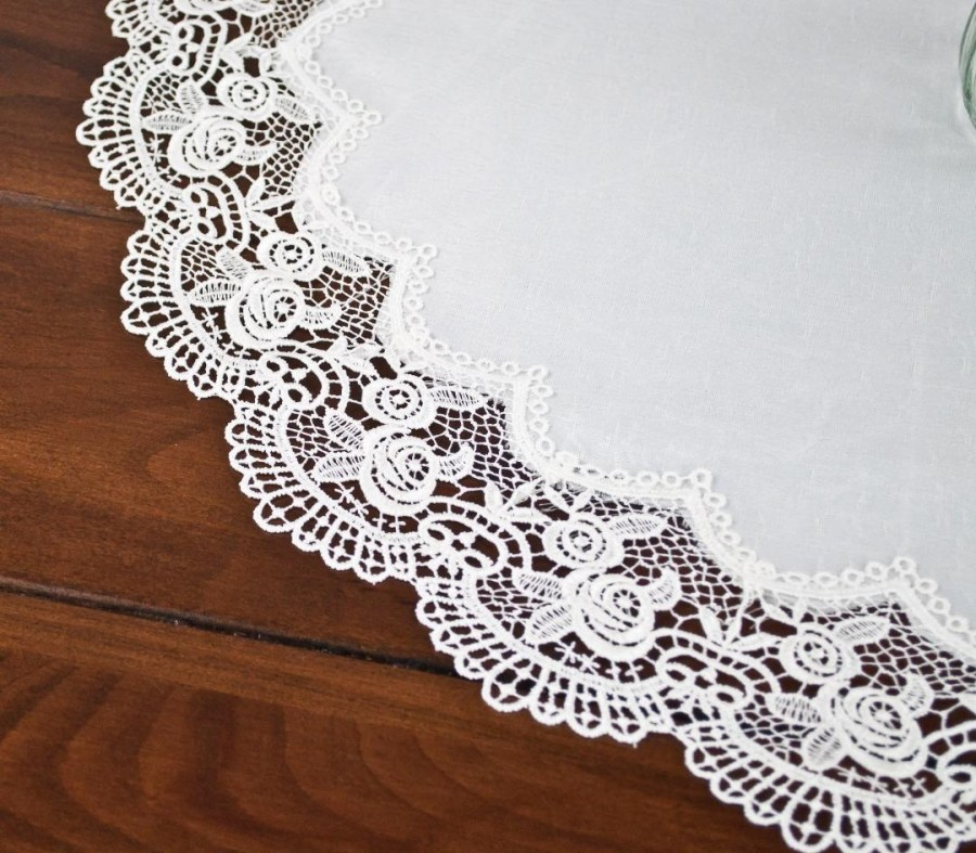 royal lace rose on white round doily
