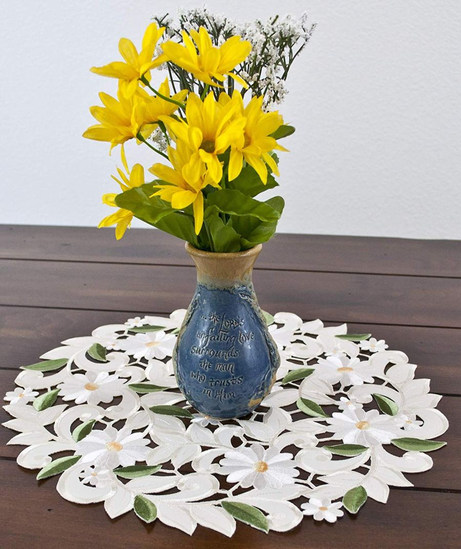 round white daisy on ivory doily