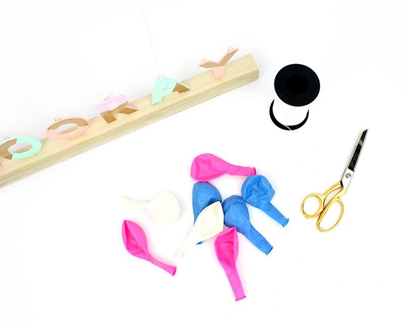 Make your own festive balloon weight centerpiece. Hooray!
