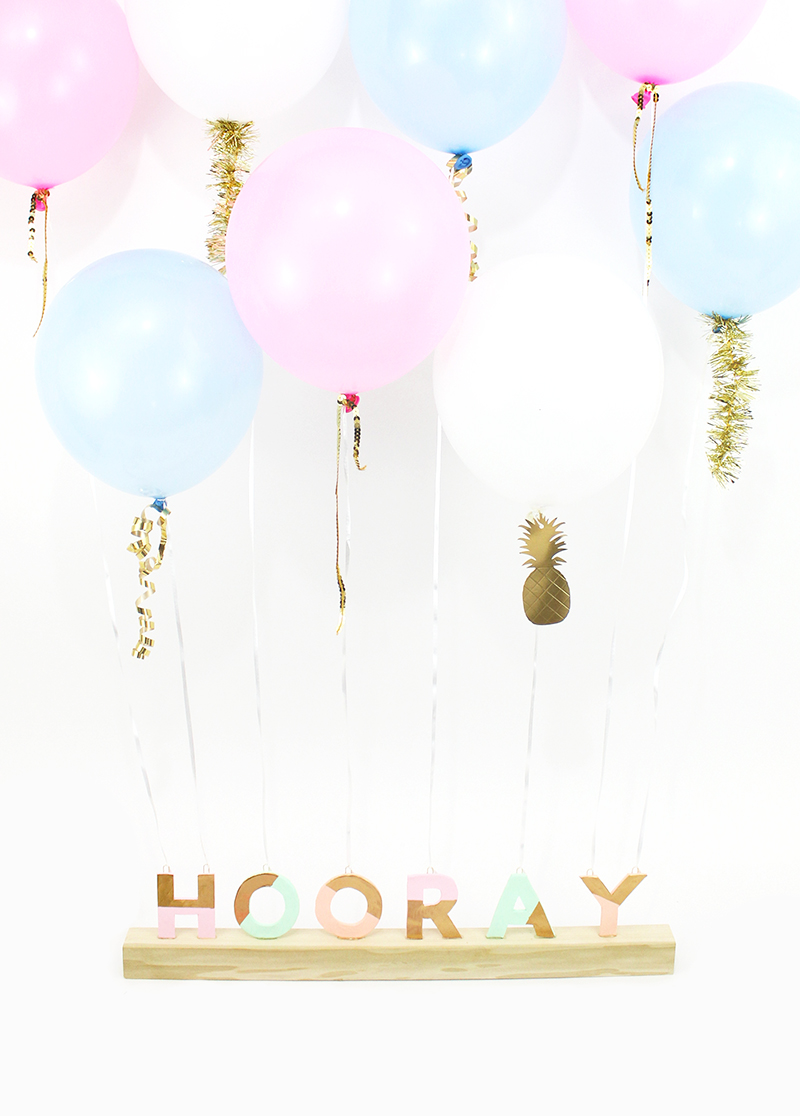 Make your own festive balloon weight centerpiece. Hooray!