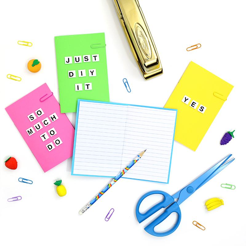 3 - Desk full of colorful handmade notebooks @linesacross