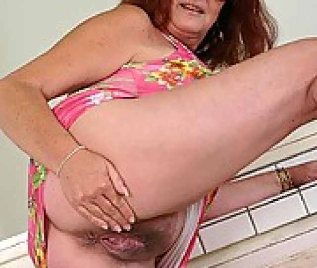 Horny Plump Granny Spreading Her Wet Pussy On The Kitchen Counter