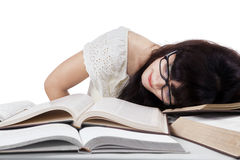 tired-student-sleeping-desk-girl-glasses-books-library-43549480